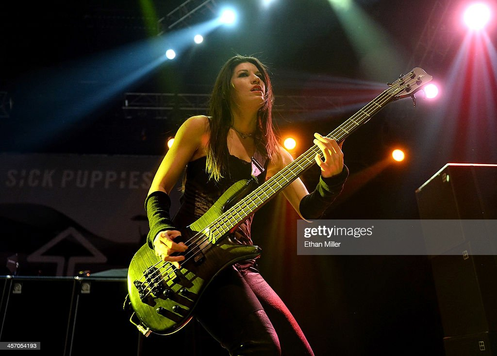 Bassist Emma Anzai of Sick Puppies performs during KOMP'S Totally Politically Correct Holiday Bash at The Joint inside the Hard Rock Hotel & Casino on December 15, 2013 in Las Vegas, Nevada.