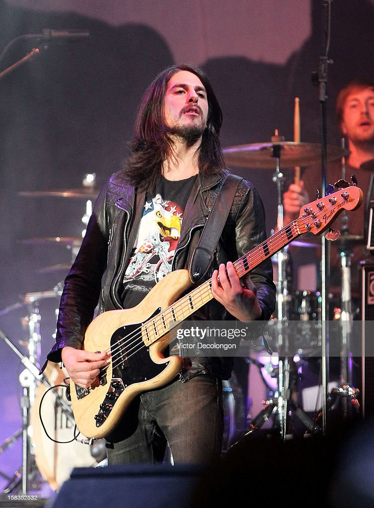 Bassist Eric Roberts and drummer Matt McGinley of Gym Class Heroes perform at the Got Your 6 And Pat Tillman Foundation Benefit on December 13, 2012 in Norwalk, California.