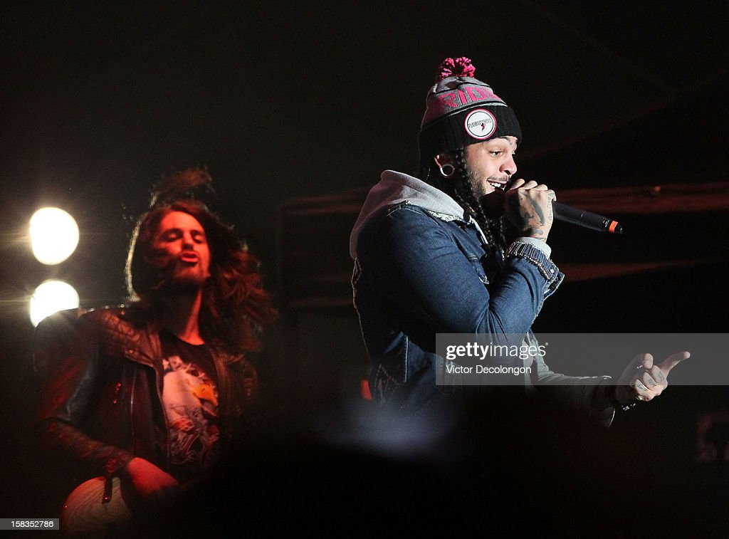 Bassist Eric Roberts and Lead vocalist Travie McCoy of Gym Class Heroes perform at the Got Your 6 And Pat Tillman Foundation Benefit on December 13, 2012 in Norwalk, California.