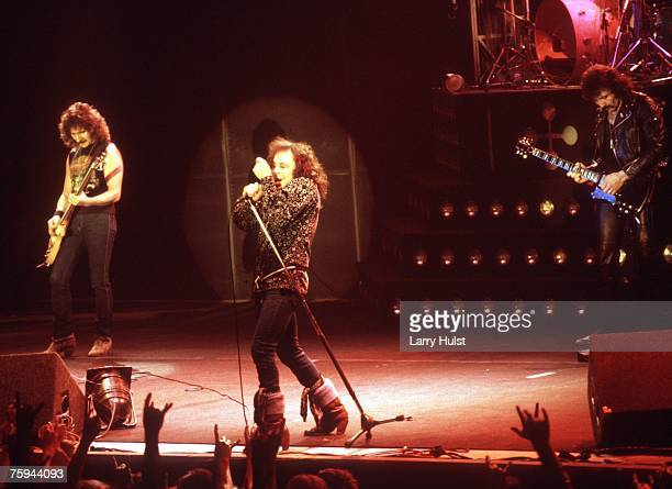 Bassist Geezer Butler singer Ronnie James Dio and guitarist Tony Iommi of the rock and roll band 'Black Sabbath' perform onstage in circa 1980