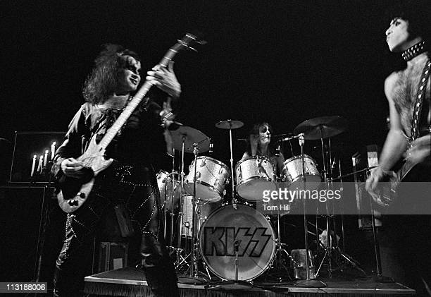 Bassist Gene Simmons drummer Peter Criss and guitarist Paul Stanley of Kiss perform at Alex Cooley's Electric Ballroom on June 22 1974 in Atlanta...