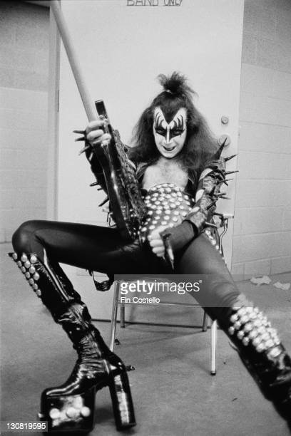 Bassist Gene Simmons of American rock group Kiss backstage at the Cobo Hall Detroit Michigan May 1975