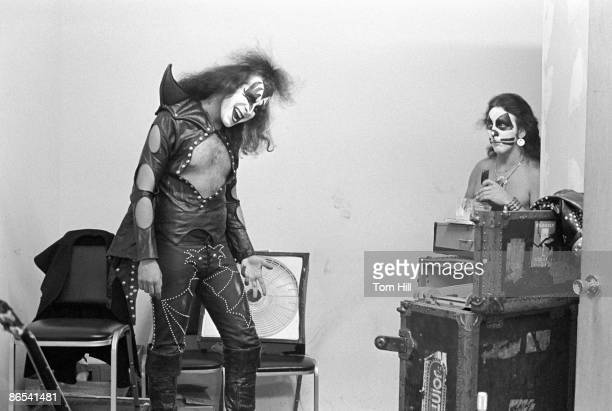 Gene Simmons of Kiss practicing his moves with Peter Criss looking on before performing at Alex Cooley's Electric Ballroom