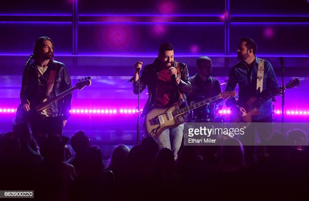 Bassist Geoff Sprung frontman Matthew Ramsey drummer Whit Sellers and guitarist Brad Tursi of music group Old Dominion perform onstage during the...