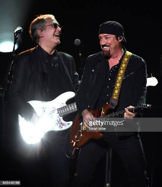 Bassist Hugh McDonald of Bon Jovi performs with guitarist/producer John Shanks at TMobile Arena on February 25 2017 in Las Vegas Nevada
