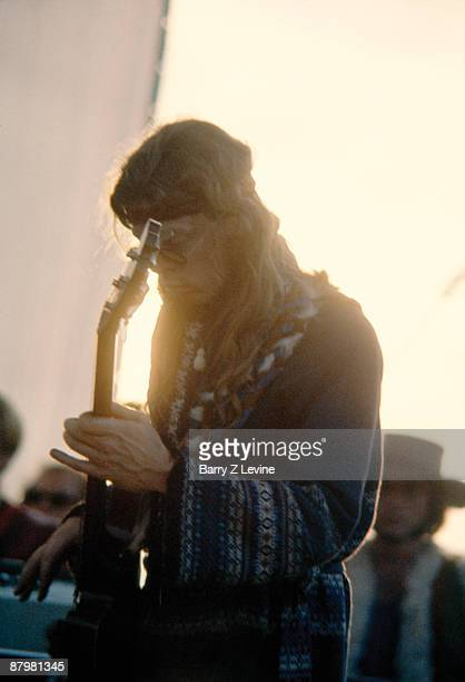 Bassist Jack Casady of the rock group Jefferson Airplane plays during the Woodstock Music and Arts Fair in Bethel New York August 15 17 1969