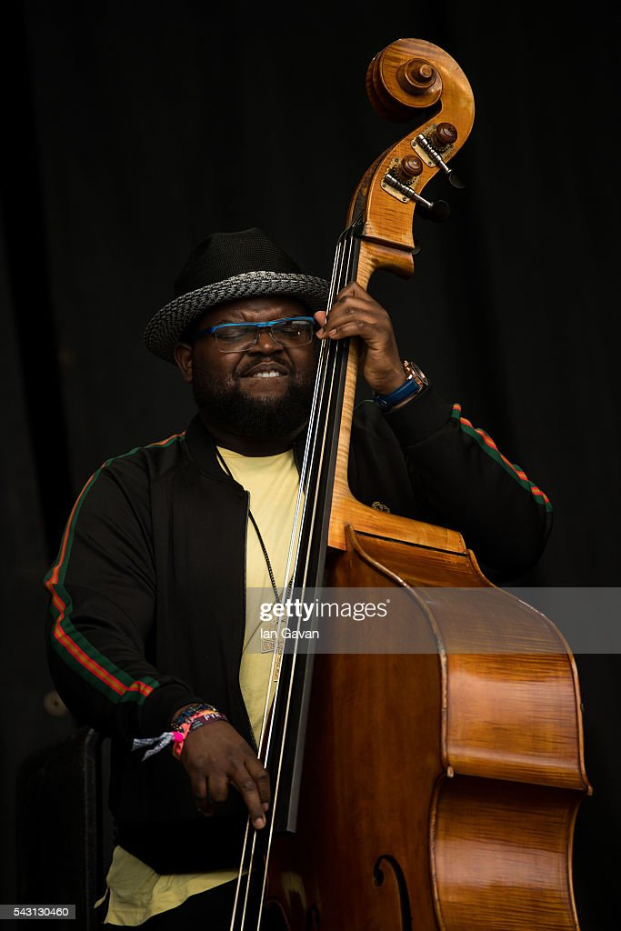 Bassist Jahmal Nichols performs with Gregory Porter on the Pyramid Stage on day 2 of the Glastonbury Festival at Worthy Farm, Pilton on June 26, 2016 in Glastonbury, England. Now its 46th year the festival is one largest music festivals in the world and this year features headline acts Muse, Adele and Coldplay. The Festival, which Michael Eavis started in 1970 when several hundred hippies paid just £1, now attracts more than 175,000 people.
