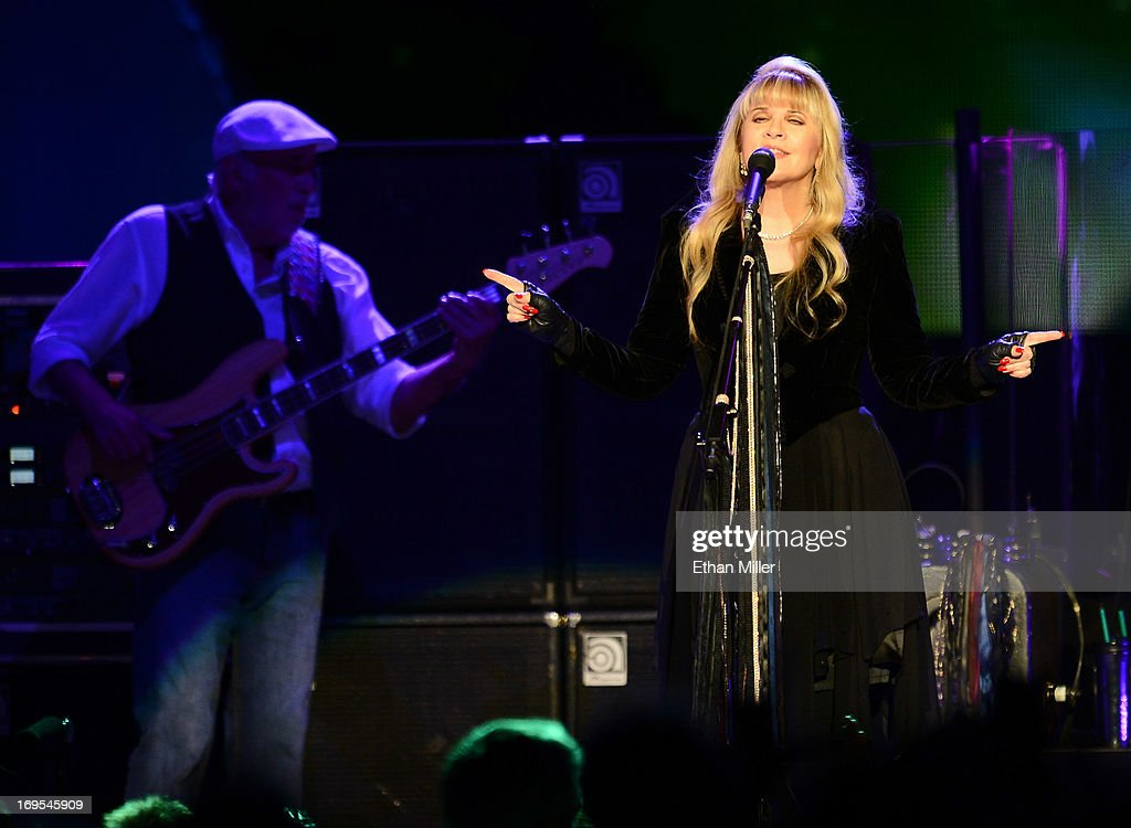 Bassist <a gi-track='captionPersonalityLinkClicked' href=/galleries/search?phrase=John+McVie&family=editorial&specificpeople=235801 ng-click='$event.stopPropagation()'>John McVie</a> (L) and singer <a gi-track='captionPersonalityLinkClicked' href=/galleries/search?phrase=Stevie+Nicks&family=editorial&specificpeople=212751 ng-click='$event.stopPropagation()'>Stevie Nicks</a> of Fleetwood Mac perform at the MGM Grand Garden Arena on May 26, 2013 in Las Vegas, Nevada.