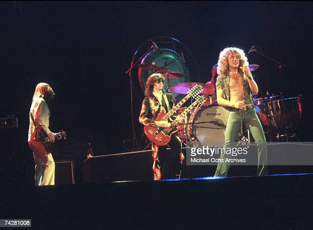 Bassist John Paul Jones singer Robert Plant and guitarist Jimmy Page of the rock band 'Led Zeppelin' perform onstage at the Forum on June 24 1977 in...