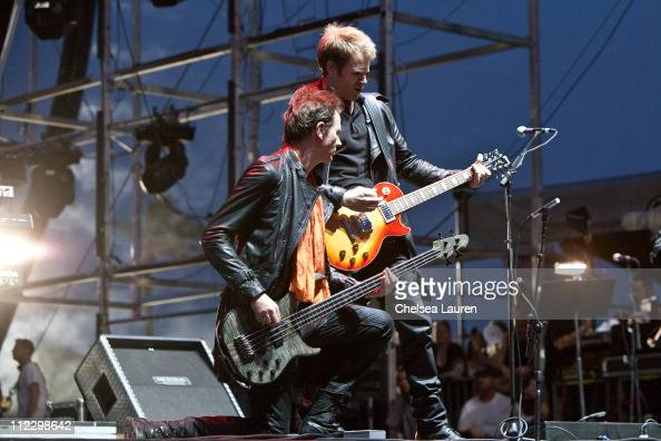 Bassist John Taylor and guitarist Dominic 'Dom' Brown of Duran Duran perform at day 3 of the 2011 Coachella Valley Music Arts Festival at The Empire...