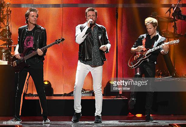 Bassist John Taylor singer Simon Le Bon and touring guitarist Dom Brown of Duran Duran perform at the 2015 iHeartRadio Music Festival at MGM Grand...