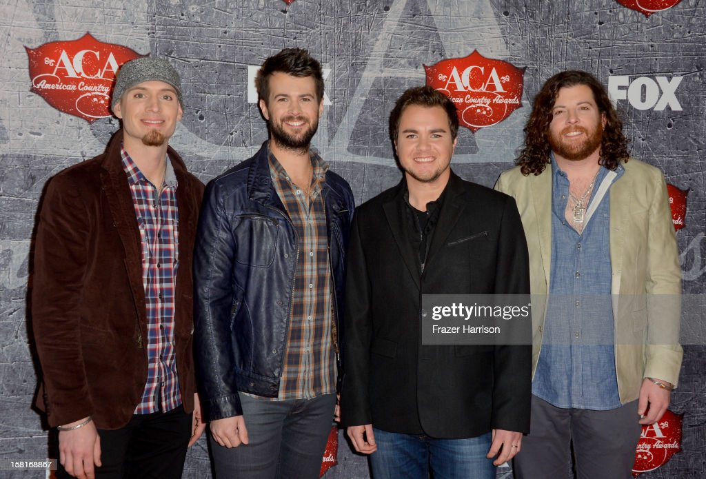 Bassist Jon Jones, drummer Chris Thompson, frontman Mike Eli and guitarist James Young of the Eli Young Band arrive at the 2012 American Country Awards at the Mandalay Bay Events Center on December 10, 2012 in Las Vegas, Nevada.