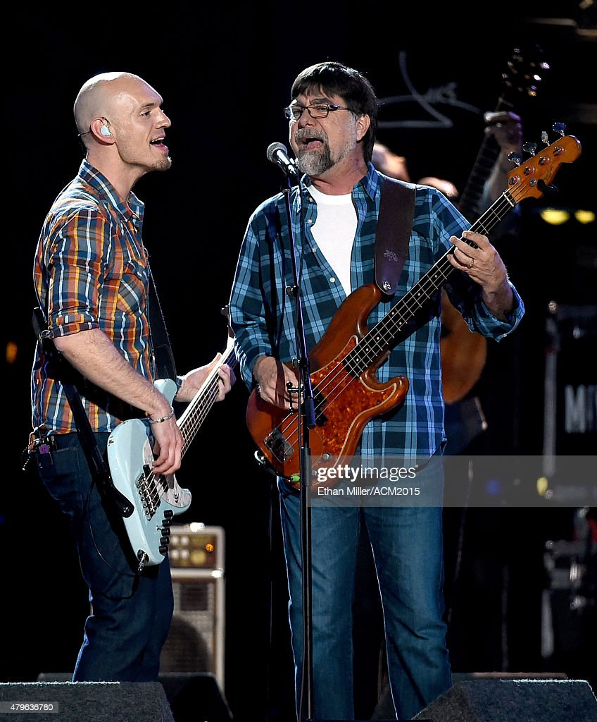 Bassist Jon Jones (L) of the Eli Young Band and bassist Teddy Gentry of Alabama perform onstage during ACM Presents: Superstar Duets at Globe Life Park in Arlington on April 17, 2015 in Arlington, Texas.