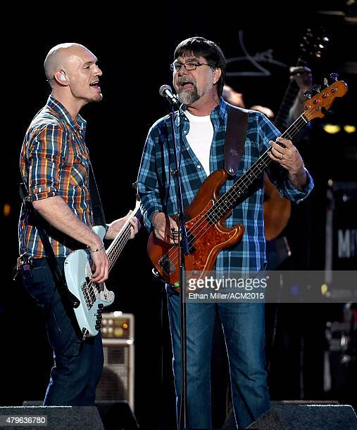 Bassist Jon Jones of the Eli Young Band and bassist Teddy Gentry of Alabama perform onstage during ACM Presents Superstar Duets at Globe Life Park in...