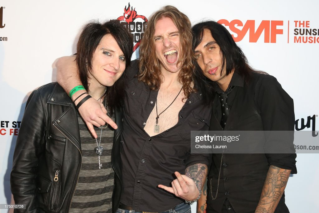 Bassist Justin Emord, vocalist Ryan Hudson and Drummer Danny Excess of Love and a .38 arrive at the 6th annual Sunset Strip Music Festival launch party honoring Joan Jett at House of Blues Sunset Strip on August 1, 2013 in West Hollywood, California.