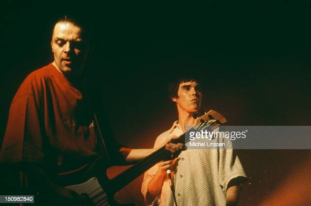 Bassist Mani and singer Ian Brown performing on stage with English rock group the Stone Roses 1995