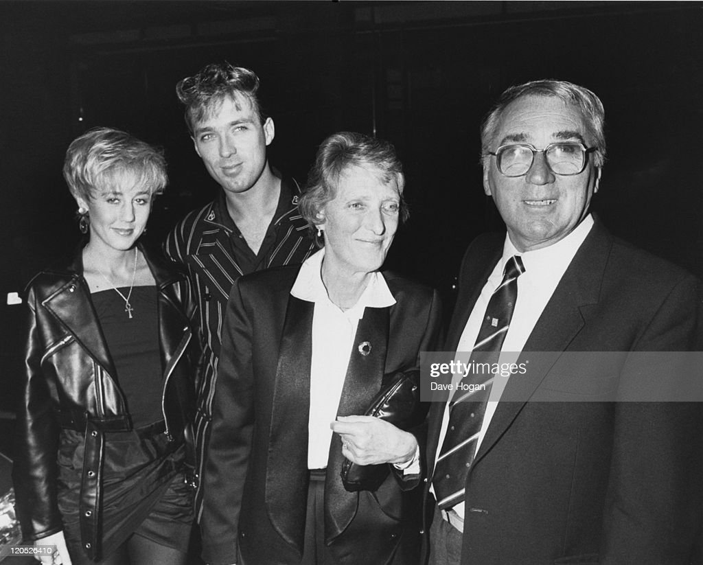 Bassist <a gi-track='captionPersonalityLinkClicked' href=/galleries/search?phrase=Martin+Kemp&family=editorial&specificpeople=213385 ng-click='$event.stopPropagation()'>Martin Kemp</a> (second from left), of British pop group Spandau Ballet, with his wife, singer Shirlie Holliman of Pepsi & Shirlie (left), and his parents, London, 8th May 1988. They are at the reception after the wedding of Kemp's brother Gary to actress Sadie Frost.
