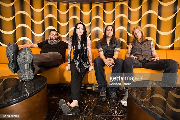 Bassist Matt Beal vocalist Sarah Anthony guitarist Mark Anthony and drummer Taylor Carroll of The Letter Black pose onboard Shiprocked cruise on...