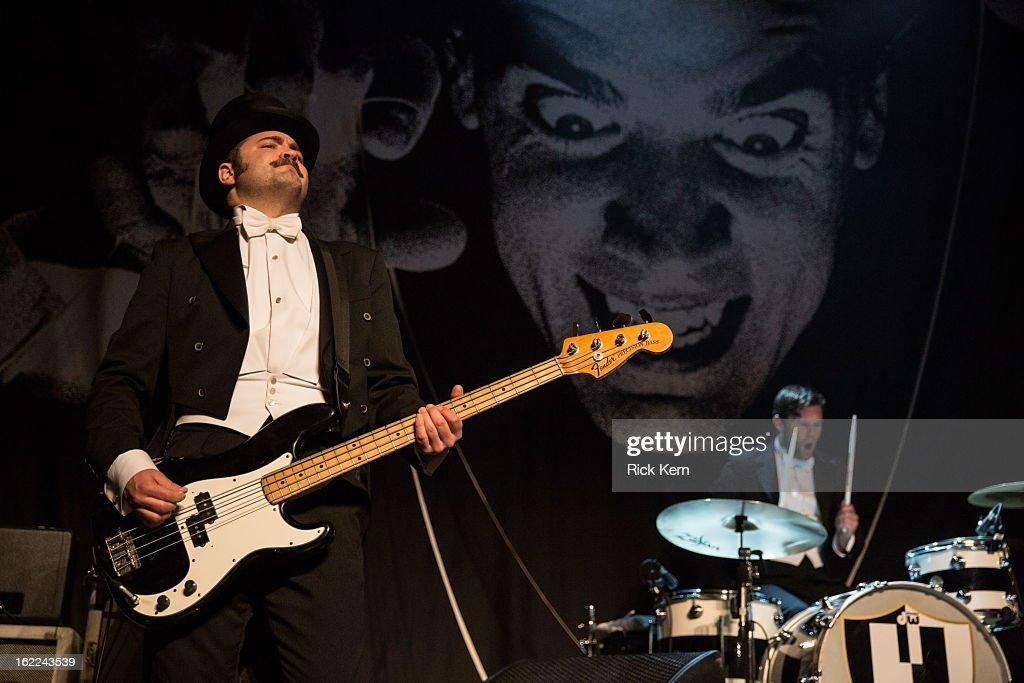 Bassist Mattias Bernvall aka Dr. Matt Destruction and drummer Christian Grahn aka Chris Dangerous of The Hives perform at Emo's East on February 20, 2013 in Austin, Texas.