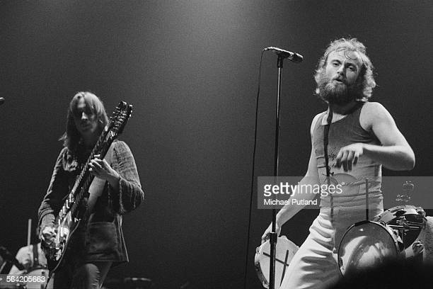 Bassist Mike Rutherford and singer Phil Collins performing on stage with English progressive rock group Genesis April 1976