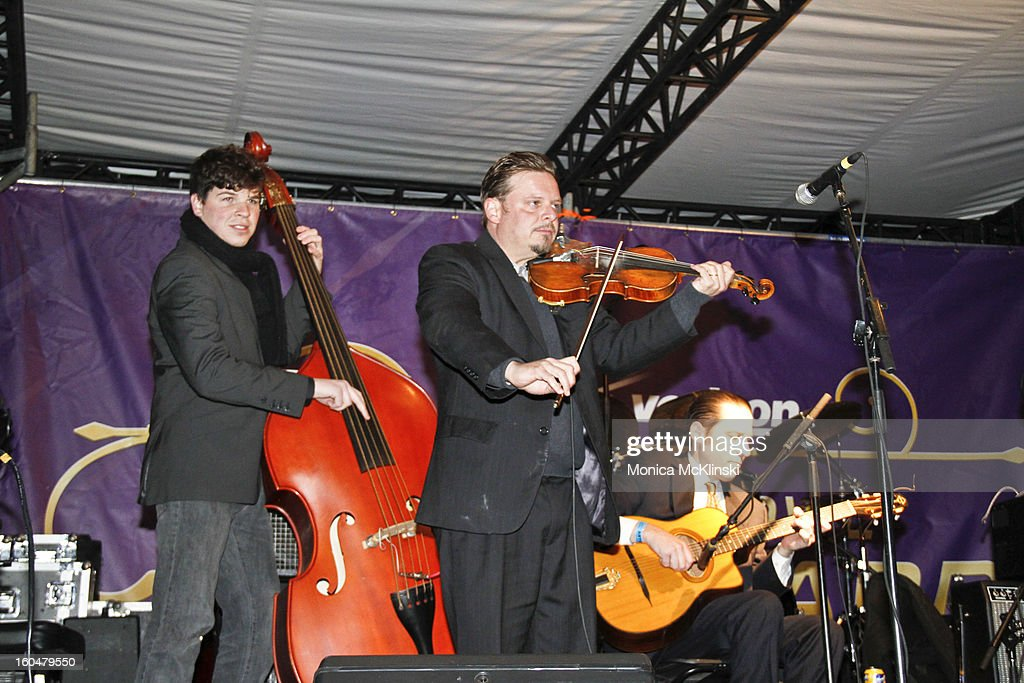 Bassist Nathan Lambertson, Violinist Matt Rhody and Guitarist John R of The Hot Club of New Orleans perform during the Verizon Super Bowl Boulevard at Woldenberg Park on January 31, 2013 in New Orleans, Louisiana.