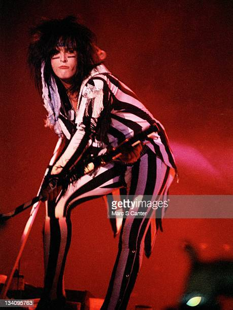 Bassist Nikki Sixx of the rock band 'Motley Crue' performs onstage at the Los Angeles Forum on August 24 1985 in Los Angeles California