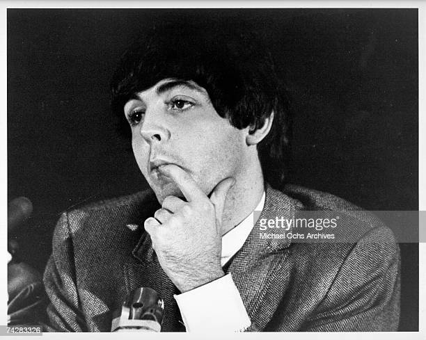 Bassist Paul McCartney of the rock and roll band 'The Beatles' answers questions during a press conference in 1965