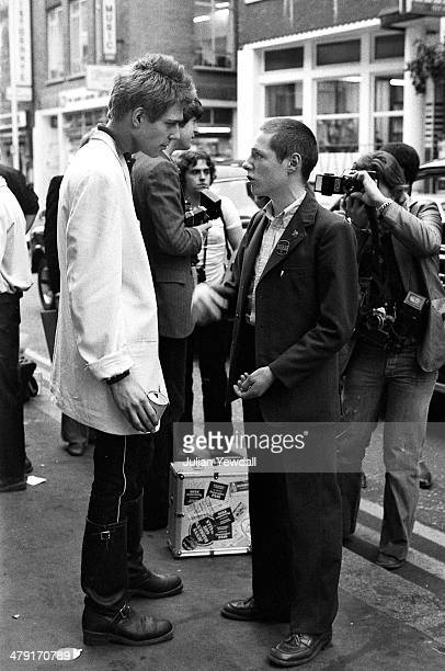 Bassist Paul Simonon of British punk group The Clash talking to a fan outside Cinema Blue in Dean Street Soho London following a press reception for...