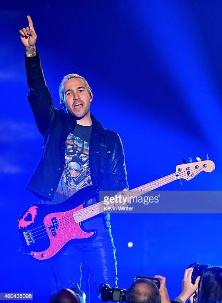 Bassist Pete Wentz of Fall Out Boy performs onstage during day one of the 25th annual KROQ Almost Acoustic Christmas at The Forum on December 13 2014...