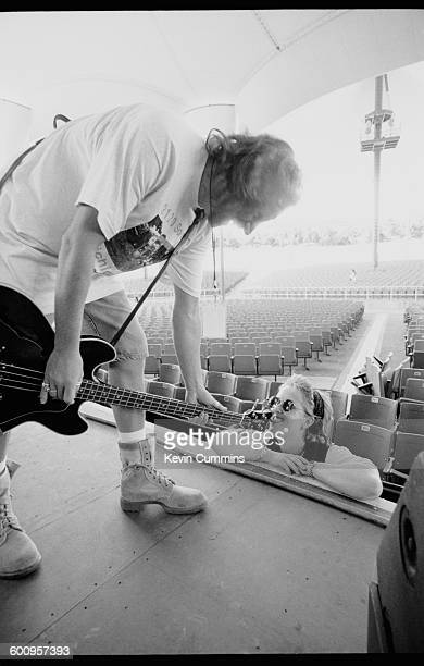 Bassist Peter Hook of English rock group New Order has his guitar licked during a soundcheck at the Kingswood Music Theatre at the Canada's...
