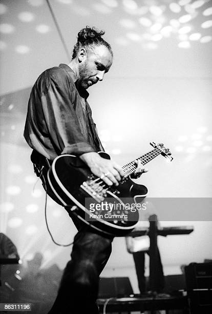 Bassist Peter Hook performing with English rock group New Order at the GMEX centre Manchester during the Festival Of The 10th Summer 19th July 1986...
