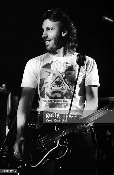 Bassist Peter Hook performing with English rock group New Order at Salford University 17th April 1985