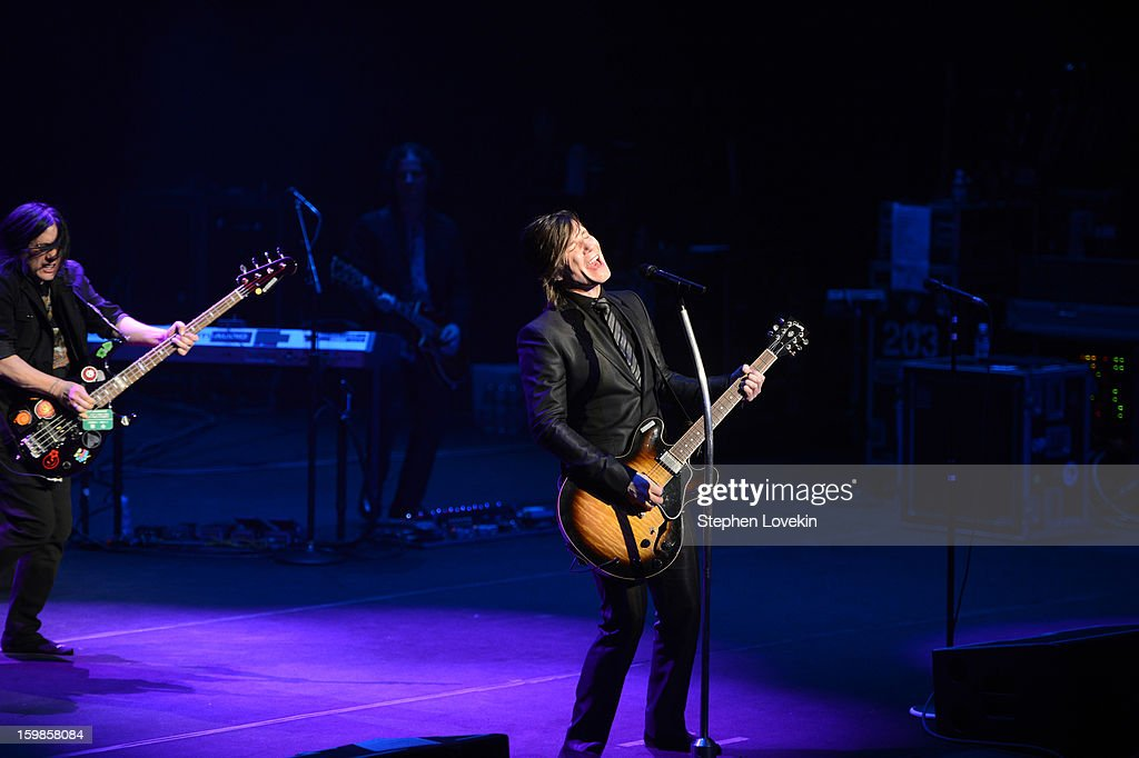 Bassist Robby Takac, keyboardist Korel Tunador, and singer/guitarist Johnny Rzeznik of the Goo Goo Dolls perform onstage at The Creative Coalition's 2013 Inaugural Ball at the Harman Center for the Arts on January 21, 2013 in Washington, United States.
