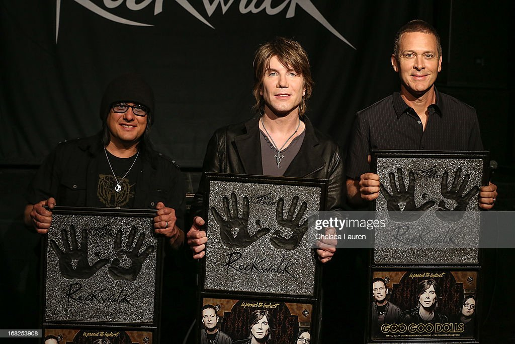 Bassist Robby Takac, vocalist / guitarist John Rzeznik and drummer Mike Malinin of Goo Goo Dolls are inducted into Guitar Center's historic RockWalk at Guitar Center on May 7, 2013 in Hollywood, California.
