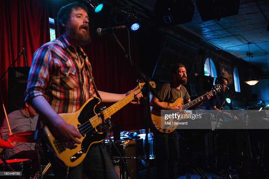Bassist Roger Dabbs (L) and singer/guitarist Matt Pelham (R) of the Features perform during an EndSession hosted by 107.7 The End at the J&M Cafe on September 29, 2013 in Seattle, Washington.