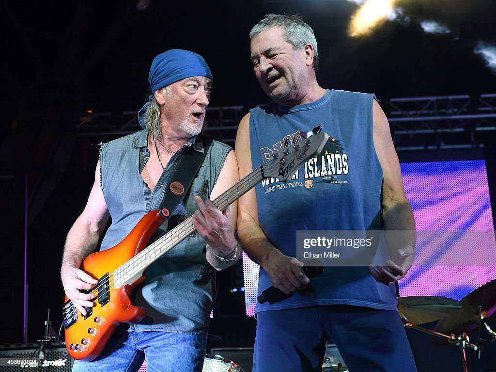 Bassist Roger Glover (L) and singer Ian Gillan of Deep Purple perform at the Fremont Street Experience on August 15, 2014 in Las Vegas Nevada.