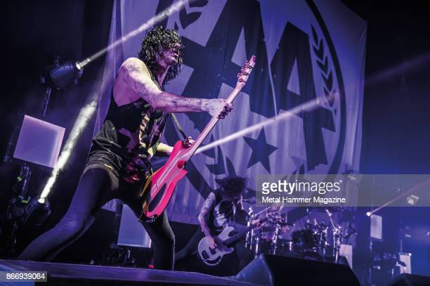 Bassist Sam Bettley and guitarist Cameron Liddell of English metalcore group Asking Alexandria performing live on stage at the O2 Academy Brixton in...