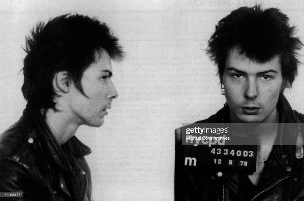 Bassist <a gi-track='captionPersonalityLinkClicked' href=/galleries/search?phrase=Sid+Vicious&family=editorial&specificpeople=860789 ng-click='$event.stopPropagation()'>Sid Vicious</a> of the rock band 'The Sex Pistols' poses for his mugshot after being arrested by New York City police for allegedly murdering his girlfriend Nancy Spungen on December 8, 1978 in New York City, New York.