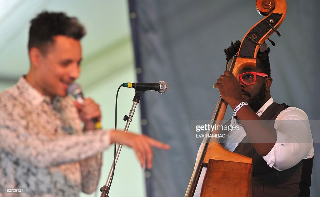 Bassist Solomon Dorsey performs with vocalist <a gi-track='captionPersonalityLinkClicked' href=/galleries/search?phrase=Jos%C3%A9+James&family=editorial&specificpeople=14698698 ng-click='$event.stopPropagation()'>José James</a> at the Newport Jazz Festival in Newport, Rhode Island, on August 1, 2015. AFP PHOTO/ Eva HAMBACH