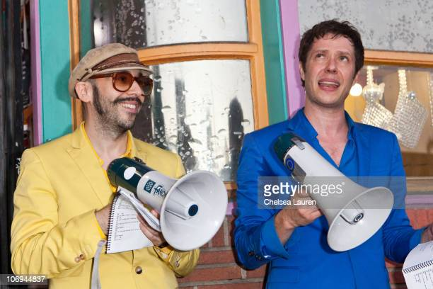 Bassist Tim Nordwind and vocalist Damian Kulash of OK Go perform a mobile concert through the streets on November 17 2010 in Hollywood California