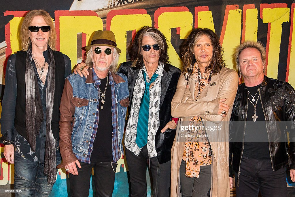 Bassist Tom Hamilton guitarist Brad Whitford guitarist Joe Perry vocalist Steven Tyler and drummer Joey Kramer of Aerosmith pose at House of Blues...