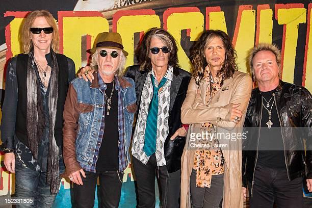 Bassist Tom Hamilton guitarist Brad Whitford guitarist Joe Perry vocalist Steven Tyler and drummer Joey Kramer of Aerosmith pose at House of Blues...