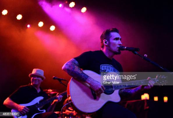 Bassist Vince Hornsby and guitarist Clint Lowery of Sevendust perform during an acoustic concert at the Marquee Theatre as the band tours in support...