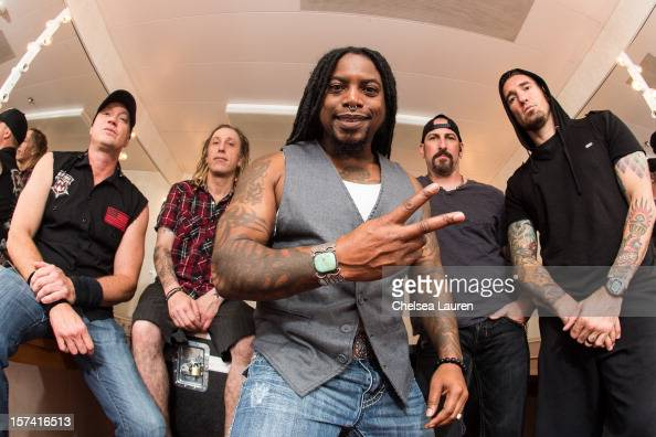 Bassist Vince Hornsby drummer Morgan Rose vocalist Lajon Witherspoon guitarist John Connolly and guitarist Clint Lowery of Sevendust pose onboard...