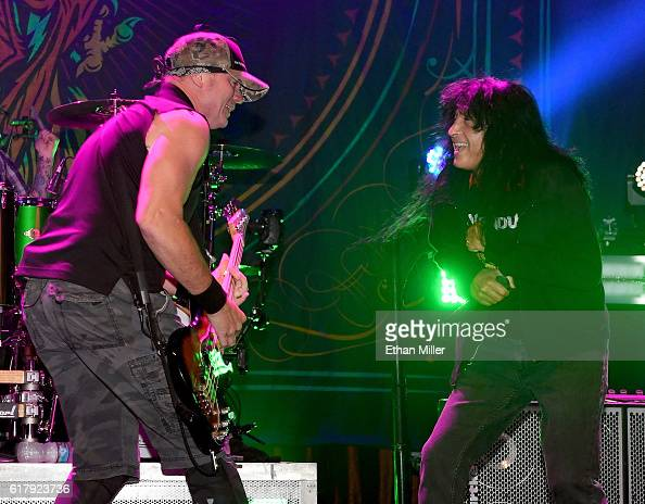 Bassist Vince Hornsby of Sevendust is joined onstage by singer Joey Belladonna of Anthrax as they perform the song 'Face to Face' during a stop of...