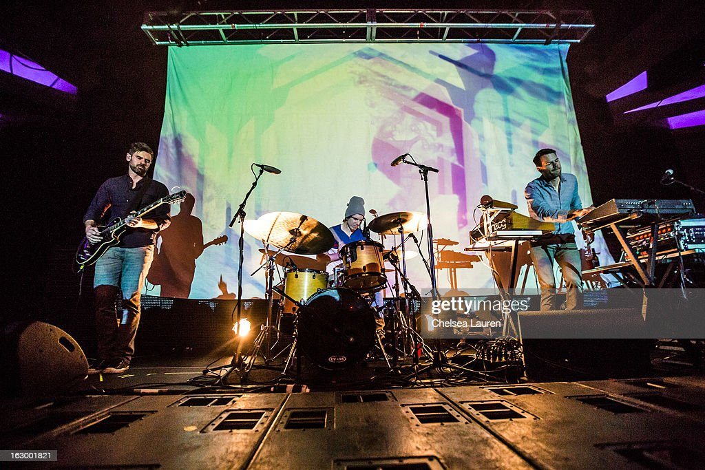 Bassist Zac Brown, drummer Rory O'Connor and producer Scott Hansen aka Tycho perform at Hollywood Palladium on March 2, 2013 in Hollywood, California.