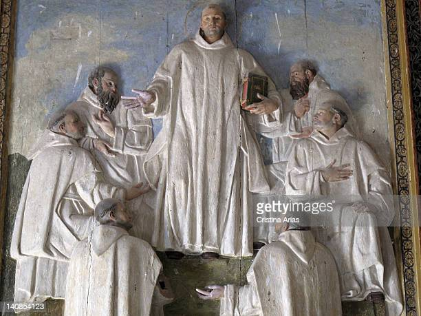 Bassrelief with San Bruno the patron saint of the Carthusian monks along with his six companions located on the eastern wall of the courtyard of the...