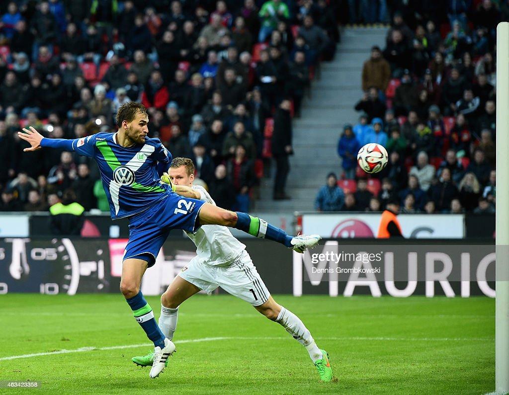 Bast Dost of VfL Wolfsburg scores the winning goal past Bernd Leno of Bayer Leverkusen during the Bundesliga match between Bayer 04 Leverkusen and...