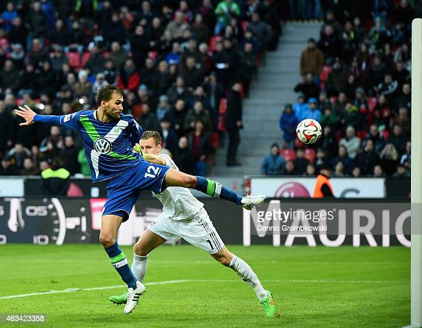 Bast Dost of VfL Wolfsburg scores the winning goal past Bernd Leno of Bayer Leverkusen during the Bundesliga match between Bayer 04 Leverkusen and...