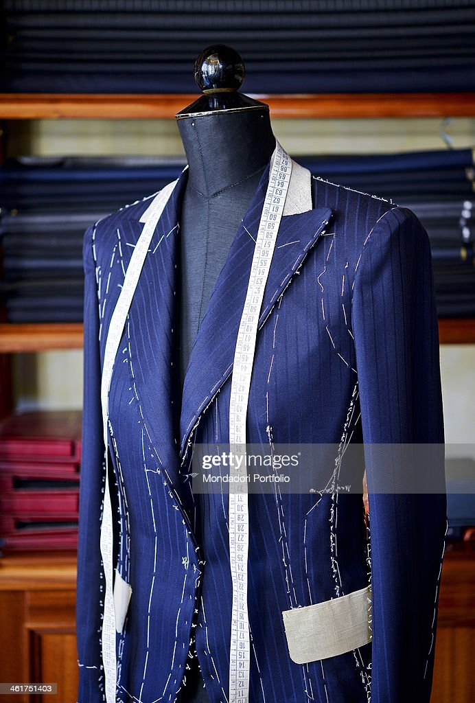 A basted jacket displayed on a dummy of the Gianni Campagna tailor's shop Milan Italy 2013